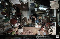 SOCO 5  These photographs of Hong Kong cubicle apartments are a disturbing combination of vertigo and claustrophobia. According to the SoCO, about 100,000 people in Hong Kong live in one of these 40-square-foot apartments, dividing their lives into small, contained areas. Taken from a bird's-eye-view, these revealing photographs give us Westerners a little more reason to be thankful.