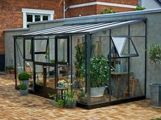 Serre jardin adossee maison
