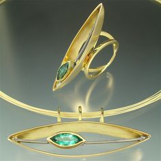 18k gold, oxidized sterling silver, tourmalime. - The stone settings freely glide back and forth.