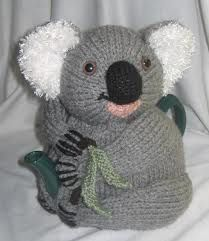 """I made this one twice in different poses – I designed him so that he could be made to sit in a variety of ways to look like a real koala. (I really dislike that """"cruciform koala"""" look! Tea Cosy Knitting Pattern, Tea Cosy Pattern, Knitting Patterns Free, Scarf Patterns, Free Knitting, Knitting Bear, Grannies Crochet, Crochet Potholders, Knitted Tea Cosies"""