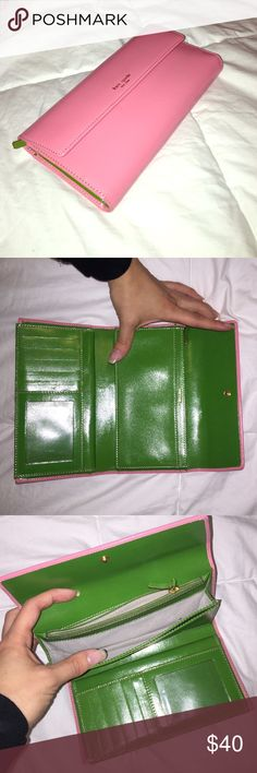 Kate Spade light pink wallet Has a check book holder as well as a pocket to put your phone in. Gently used, in great condition. kate spade Accessories Key & Card Holders