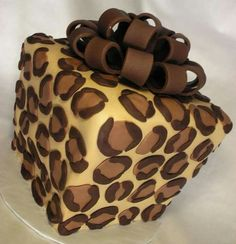 "We specialize in CakeCheeseCake Presents! Luscious layers of cake AND cheesecake ""gift wrapped"" in white chocolate and topped with a sugar bow! Wedding Cakes, Birthday cakes or any occasion cakes! Cheetah Print Cakes, Leopard Cake, Leopard Room, Leopard Spots, Pretty Cakes, Beautiful Cakes, Amazing Cakes, Cupcakes, Cupcake Cakes"