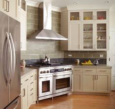 cooking dinner is made even easier when the stovetop is flanked by pullout pantries shaker cabinets with sleek brushed nickel hardware are set agau2026