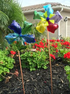 TishArtGlass - fused glass pinwheels in my front yard :) Love how they turned out.