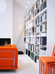 Orange sofa and chair. Kallax, Hemnes, Wall Bookshelves, Book Shelves, Bookcases, Catalogue Ikea, Austin Apartment, Orange Sofa, Happy Room