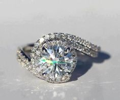 Gorgeous, but very much like Ruth's. Love the design, too many small diamonds. 7/10