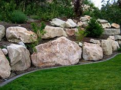 boulder retaining wall offers the experience of 200000 square feet of rock retaining walls - Rock Wall Garden Designs