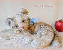 Gato Steiff Fiffy, edición de 10 pulgadas más grande mentira gato mohair, con cabezal giratorio, botón de Steiff, etiqueta, etiqueta de pecho, producido solamente 1955-62