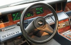 The first application of an electronic instrument cluster, in a production automobile — Aston Martin Lagonda 1976 Production