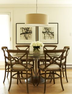 round metal table, smaller scale chairs, drum shade, art   Cameron MacNeil