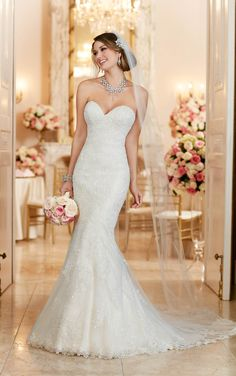 Simply perfect. This modified fit and flare designer bridal gown from Stella York features romantic, beaded lace over satin. Choose from a corset closure or a zipper closure under Stella crystal buttons.