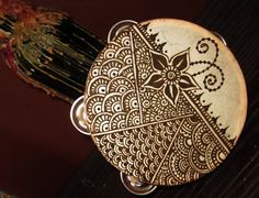 goatskin tambourine with a henna mehndi floral themed design
