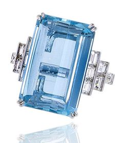 An aquamarine and diamond ring, Sophia D. centering a rectangular-cut aquamarine with baguette-cut diamond six-stone shoulders and a plain mount; signed Sophia D., no. 2666; aquamarine weighing approximately: 18.00 carats; mounted in platinum.
