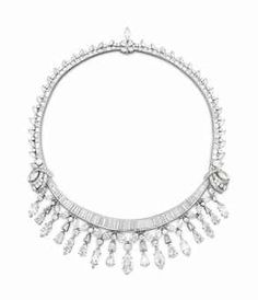 A DIAMOND NECKLACE The front suspending a pear, circular, marquise and trapezoid-shaped diamond fringe from a baguette-cut diamond swag, centering upon a marquise-cut diamond, weighing approximately 2.42 carats, intersected by baguette, marquise and circular-cut diamond plaques to the backchain of similar design, 16 ins., mounted in platinum