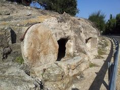 This tomb was exposed during a road construction on the way to Megiddo in the hills of Manasseh. It is one of the best examples of a stone covering a burial cave. This stone is indeed very heavy the weight is estimated at over 1.5 tons. Location: Emek Yizrael, Israel