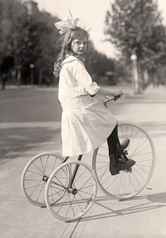 They see me rollin'. Girl Riding Tricycle; Marye, Helen. 1913 and 1917 by Harris & Ewing.