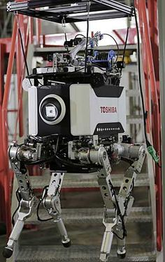 The Toshiba robot climbs stairs during a demonstration in Yokohama on Wednesday. Itsuo Inouye/AP Photo