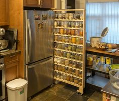 A spice rack to fit 72 mason jars worth of spices and herbs. - Imgur