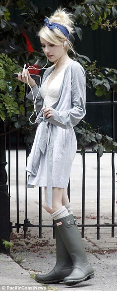Unusual attire: For a top, Emma wore a lacy bra with no shirt over it - only a pale grey wrap tied loosely around her waist