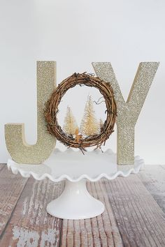Glittered Woodland Decor. Using wood letters and a grapevine wreath. So pretty!