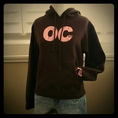 """Roxy """"OC"""" Hoodie Roxy """"OC"""" Hoodie Chocolate brown with pink screening The design is made to look crackled Purchased at Downtown Disney and used for the day because of unexpected rain EUC, no signs of wear or damage Roxy Tops Sweatshirts & Hoodies"""