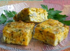 Petite baked appetizer squares made with egg, cheddar cheese, marinated artichoke hearts, green onion, parsley and crumbled crackers.