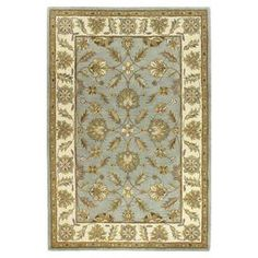 Hand-tufted wool rug with floral motif.  Product: RugConstruction Material: 100% WoolColor: Light blueFeatures: Hand-tuftedNote: Please be aware that actual colors may vary from those shown on your screen. Accent rugs may also not show the entire pattern that the corresponding area rugs have.Cleaning and Care: Regular vacuuming and spot cleaning recommended