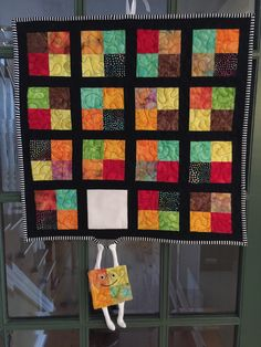 """The """"runaway quilt block"""" wall hanging My version is batiks framed in black... 20"""" x 20"""""""
