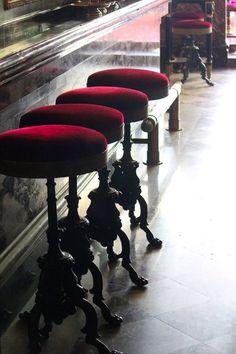 Red velvet bar stools at a cafe in Laduree, Paris