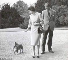 Queen Elizabeth with Prince Philip and a corgi
