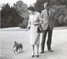 Queen Elizabeth with Prince Philip and a corgi