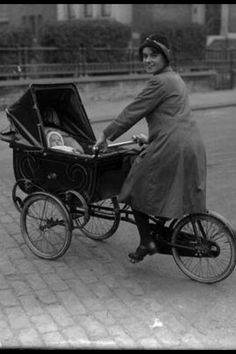 Baby in stroller bike. With mom.