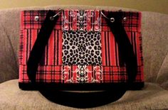 This fun mid tote is big enough to hold a bottle of wine! It has a bright red lining and seven inside pockets to keep all your stuff organized.  It also has feet for protection.  $175.00 Diaper Bag, Totes, Bright, Pockets, Wine, Bottle, Red, Bags, Handbags