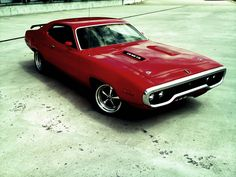 Plymouth GTX Roadrunner.   Some people talk about buying a Ferrari, Porsche or Lamborghini.  I would rather have four completely restored & modernized muscle cars all day long.