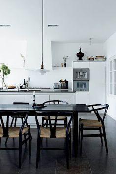 Black Wegner chairs and white kitchen