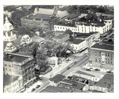 Courthouse square. The former Central National Bank building stands to the left of the Courthouse. At the time the CNB building was on of the tallest buildings in Southeastern Ohio at five stories. Diagonally from the CNB stands the Craig Building.