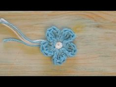 (crochet) How To Crochet a Mini Flower - Yarn Scrap Friday. This tutorial is for the small flower that accompanies my amigurumi rabbit, but it is perfect as a stand alone tutorial for any project. Amigurumi Rabbit Tutorial Part . Crochet Bunny Pattern, Crochet Bear, Crochet Patterns Amigurumi, Crochet Motif, Crochet Dolls, Crochet 101, Tutorial Crochet, Free Crochet, Crochet Puff Flower