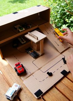 Turn a cardboard box into an awesome garage with this easy DIY activity that's perfect for on-the-go fun with Hot Wheels!