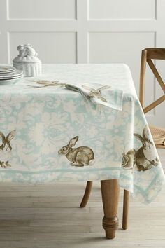 This damask and rabbit tablecloth print will fit right in at the farmhouse. #easter #easterflowers #easterdecor #easterdecorations