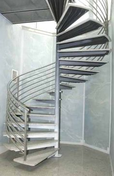 Stainless Steel spiral stairs with Granite Treads