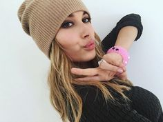 Hailey Baldwin throwing it up with her pink lokais!