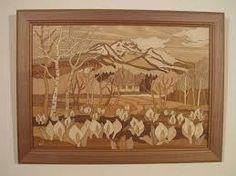 「木で描く」 木の色の違いだけで、一つの絵が完成している。大変細かいが、奥行きも感じられバックの山も綺麗に描かれている。
