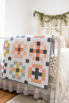 Crossroads quilt pattern by Emily of Quiltylove.com. Modern fat quarter friendly quilt using all solids. Throw quilt, baby quilt and queen sizing.  Modern quilt pattern.  #quiltylovepatterns #modernquilting