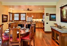 Kitchen and Dining with Hardwood Plank Flooring