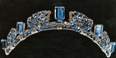 """Cartier """"pine cone"""" or """"pine flower"""" tiara of aquamarines, given to Queen Elizabeth, the Queen Mother by her husband, King George VI as an anniversary present.  Passed on to the Princess Royal.  A little odd in design, but pretty stones."""