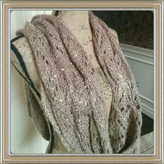 Taupe with a touch of sparkle infinity scarf So pretty is this taupe colored infinity scarf. Has pretty gold colored sparkles. Beautiful cond. Never worn. Polyester acrylic blend. Faded Glory Accessories Scarves & Wraps