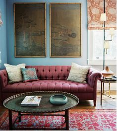 A palette perfect for a high Depth value. Muted, tonal, thoughtful shades of familiar blue and wine. Point and counterpoint: the cerulean blue-green dish on the coffee table and the terracotta of the curtain. (commentary via The Voice Bureau | AbbyKerr.com)