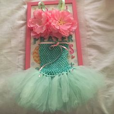 Mermaid Toddler Tutu ; Baby girl clothing Great mermaid costume for baby girls 1st Birthday. In great condition worn once. Pink and Mint mermaid tutu custom made. Starfish on left bra top is broken but barely noticeable, a piece has been glued back on.  Small pieces on this outfit is a choking hazard, seller is not responsible for accidents. Tops