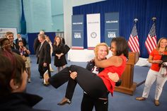 The First Lady gets a lift by U.S. Olympic wrestler Elena Pirozhkova while meeting with Team USA at the 2012 Summer Olympic Games in London, July 27, 2012.