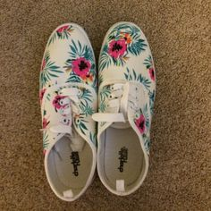 NWT floral canvas tennis shoes NWT adorable floral sneakers.  These still have the size sticker on the bottom and haven't even been unlaced from when I first bought them.  Never worn. Charlotte Russe Shoes Sneakers